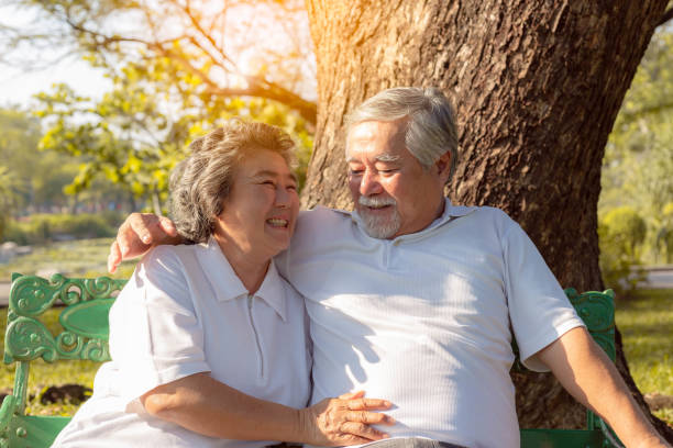 happy life and long lived concept. beautiful older woman feel happiness when grandma stay with beloved husband or grandfather. charming grandparent love each other for long time. they have good health - 80 89 лет стоковые фото и изображения