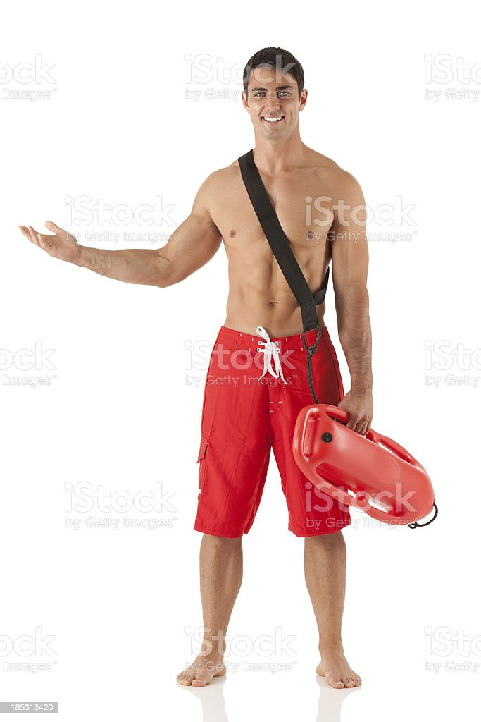 Happy lifeguard holding a float and gesturing royalty-free stock photo