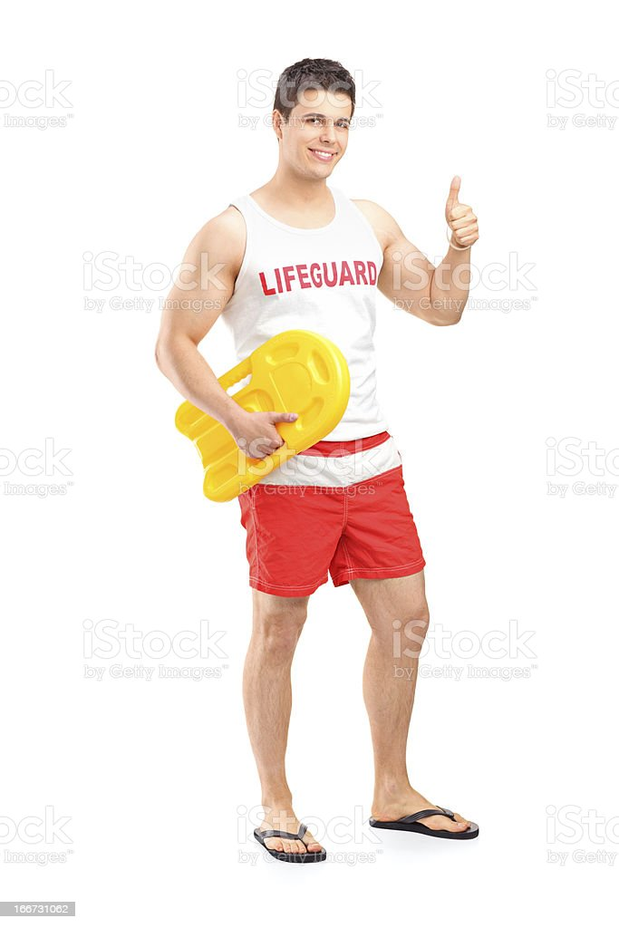 Happy lifeguard on duty giving a thumb up stock photo