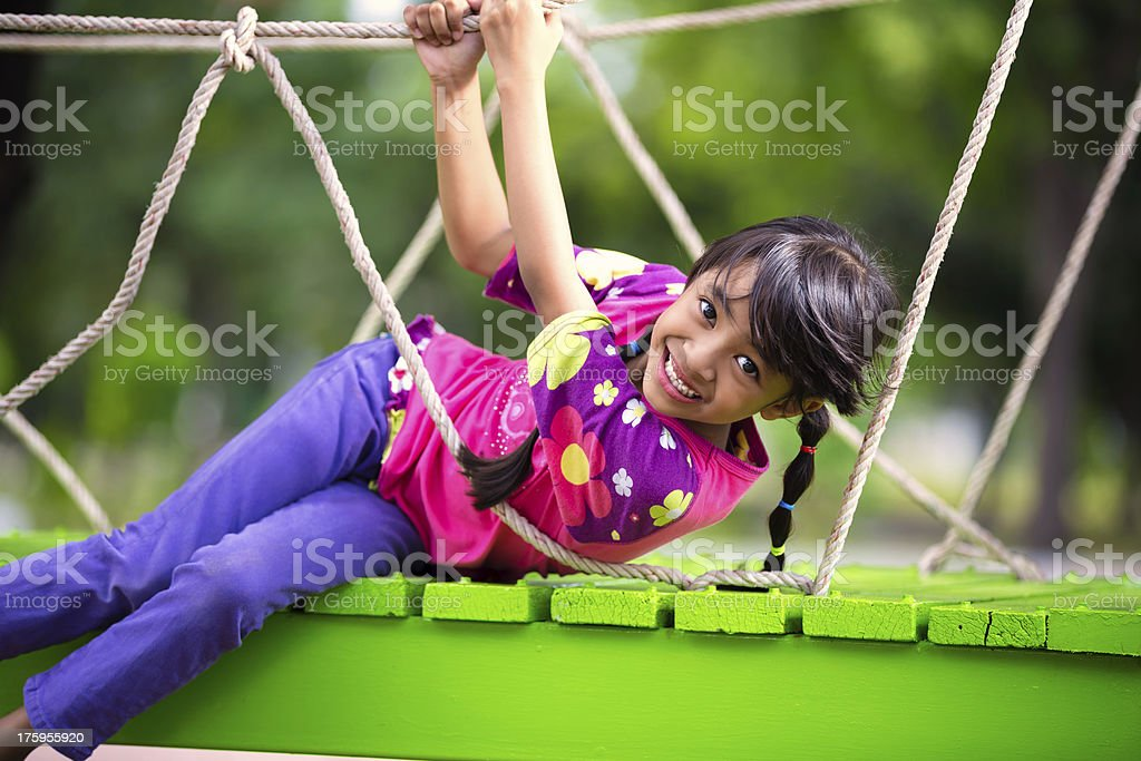 Happy little asian girl on the playground royalty-free stock photo