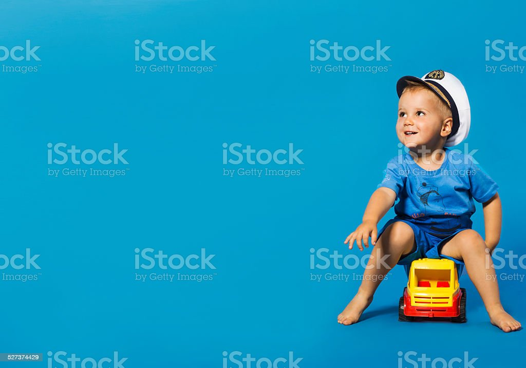 Happy little blond boy with sailor hat stock photo