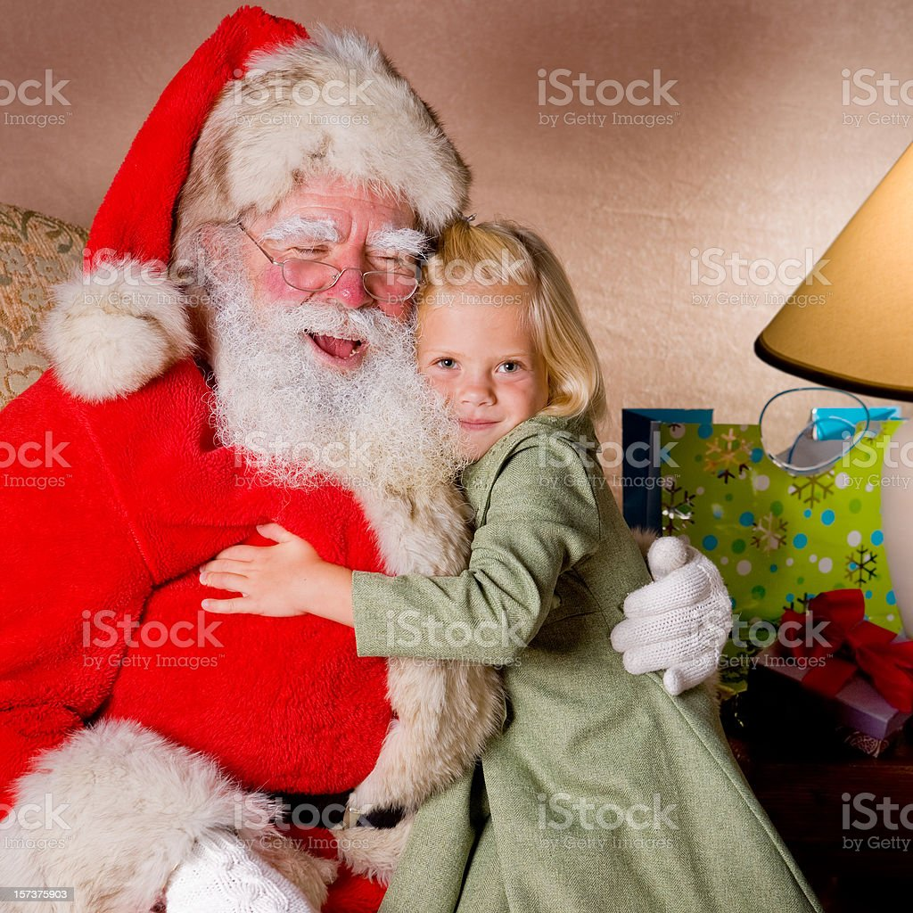 Happy little blond girl with Santa royalty-free stock photo