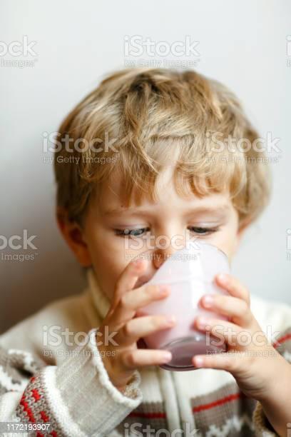 Happy little blond kid boy drinking milk or strawberry milkshake for picture id1172193907?b=1&k=6&m=1172193907&s=612x612&h=x2vyjreodzuf8iawvo2fxkfudehc2qyqdzyurnzaidg=