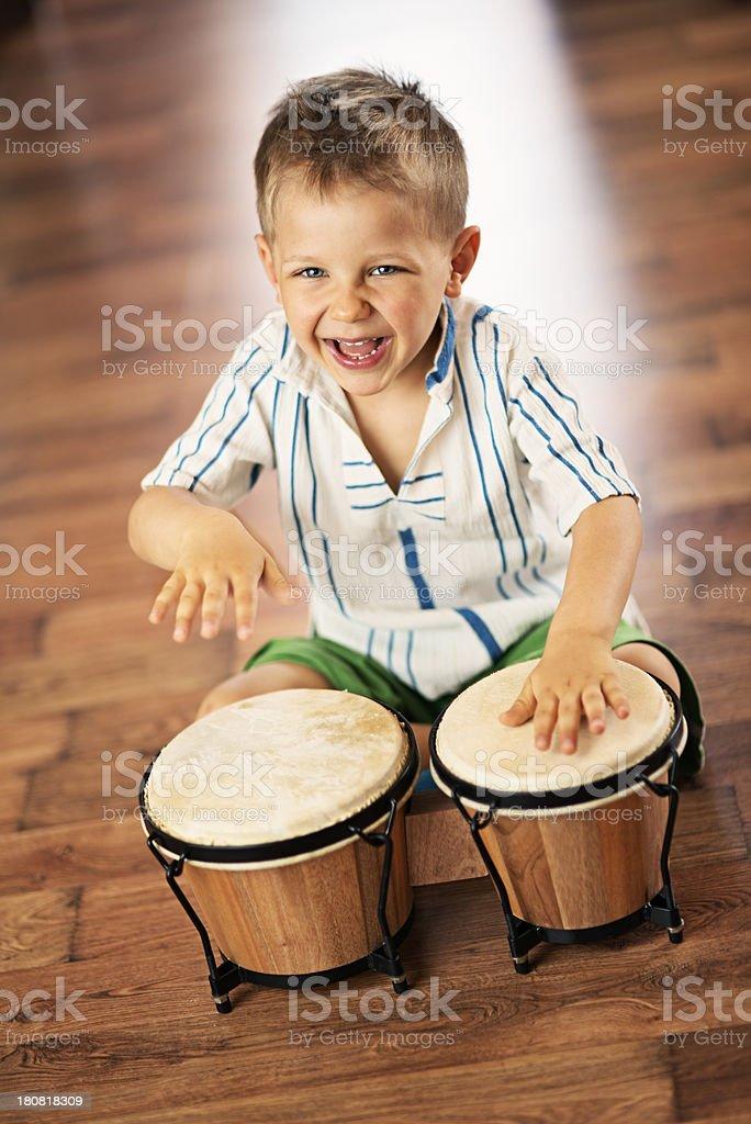 Happy little bongo drummer stock photo