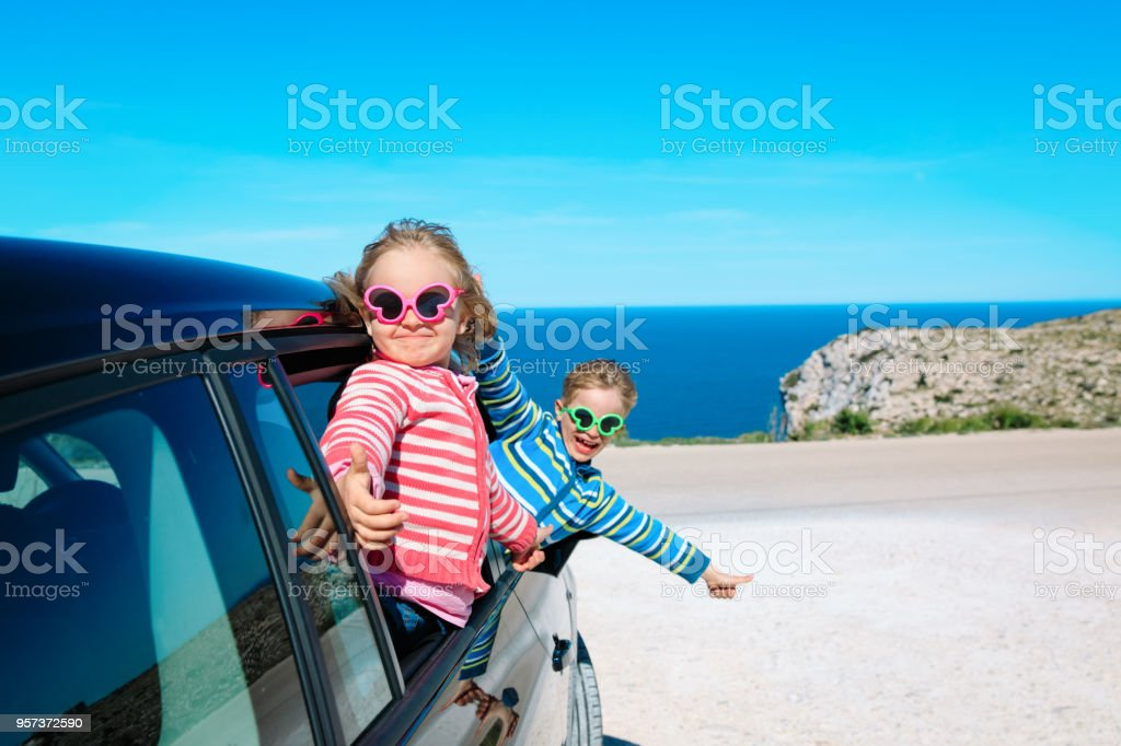 happy little boy and girl enjoy travel by car at sea stock photo