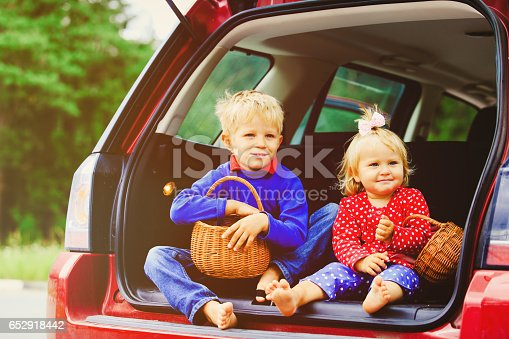915609494istockphoto happy little boy and girl travel by car 652918442