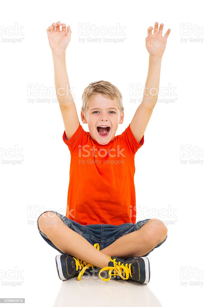 happy little boy arms up stock photo