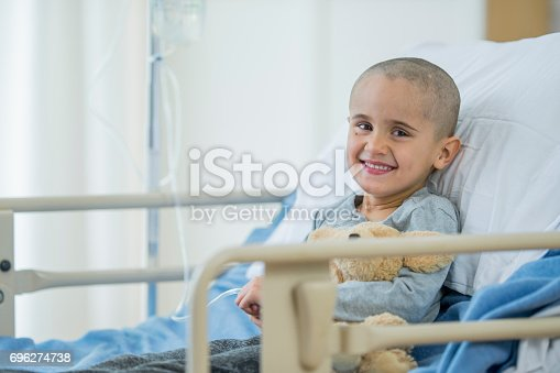 istock Happy Little Boy Battling With Cancer 696274738