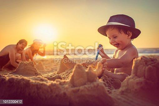 Cute child enjoying summer by the sea