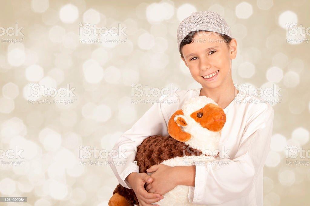 Happy little boy celebrating Eid ul Adha stock photo