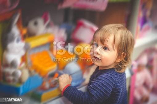 Cute child in toy store