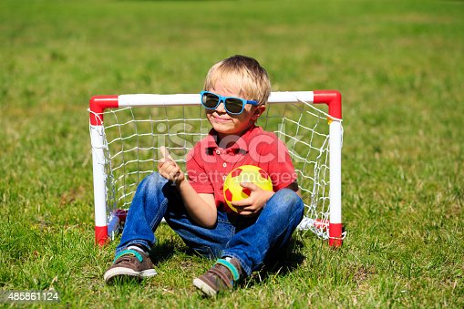 621475196 istock photo happy little boy enjoy playing football 485861124