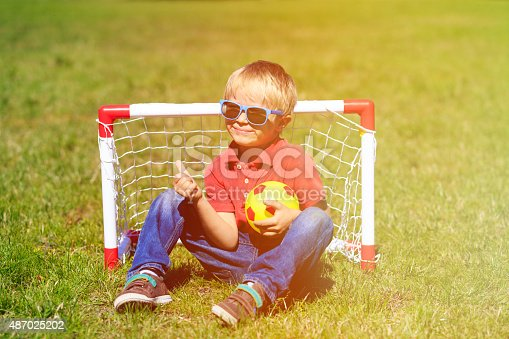621475196 istock photo happy little boy enjoy playing football 487025202