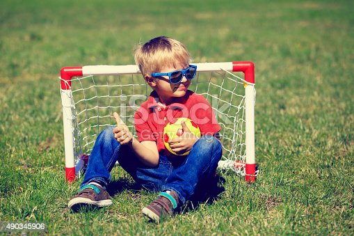 istock happy little boy enjoy playing football 490345906