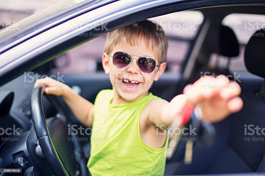 Happy little boy getting over the top present stock photo