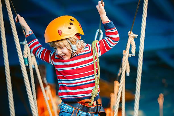 happy little boy having fun outdoor, playing and doing activities - mini amusementpark stockfoto's en -beelden