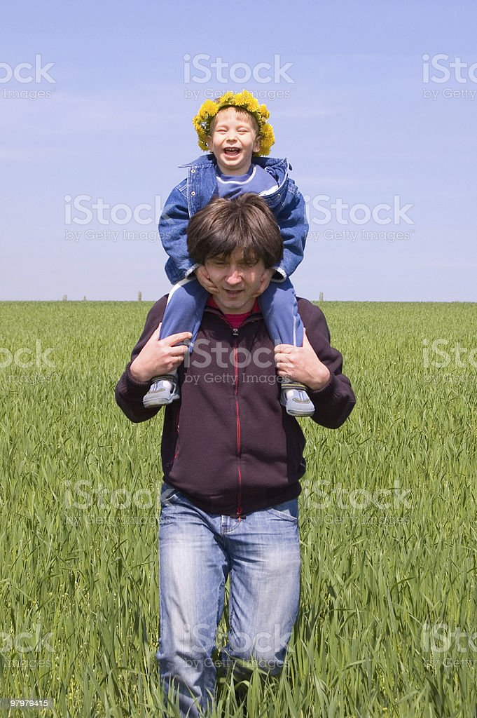 happy little boy is on his father royalty-free stock photo