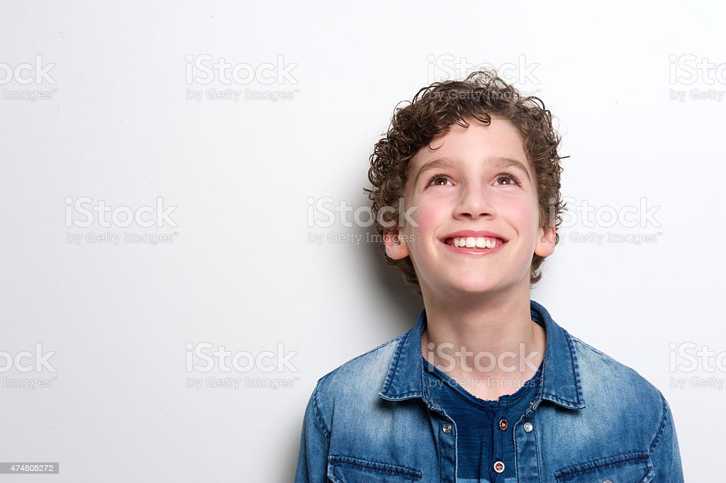 happy little boy looking up stock photo