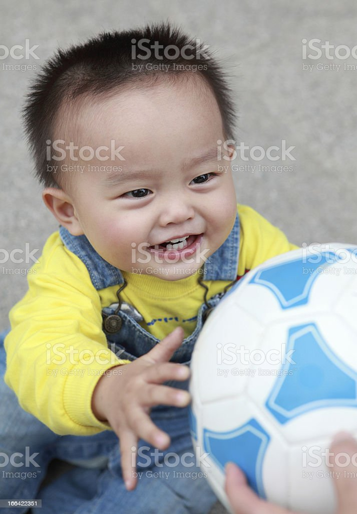 Happy little boy playing soccer royalty-free stock photo