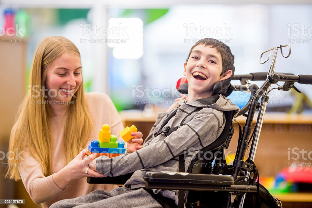 Happy Little Boy Playing with Toys stock photo