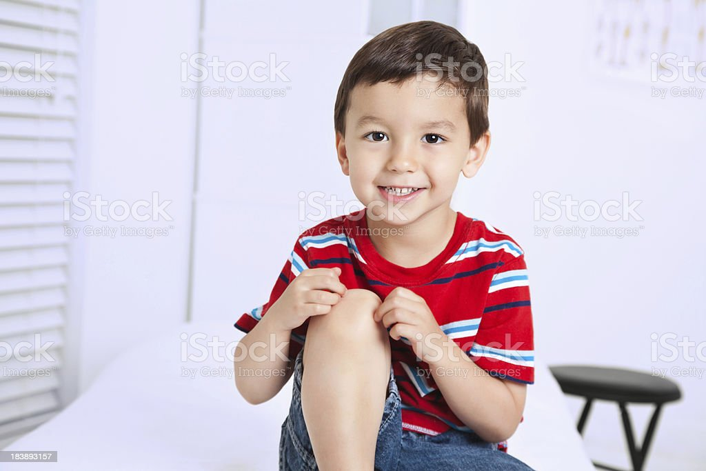 Happy Little Boy Sitting In Doctor's Office royalty-free stock photo