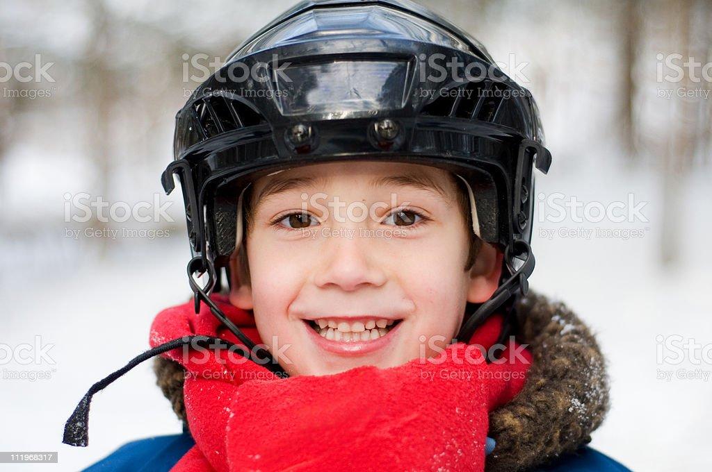 happy little boy wearing a hockey helmet royalty-free stock photo