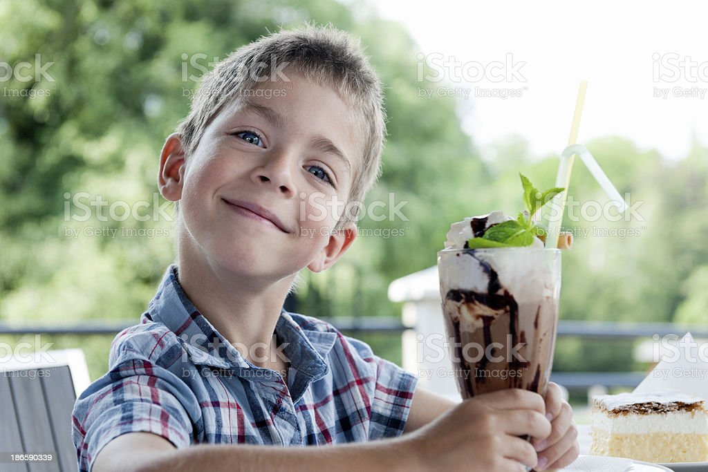 happy little boy with big ice cream sundae stock photo