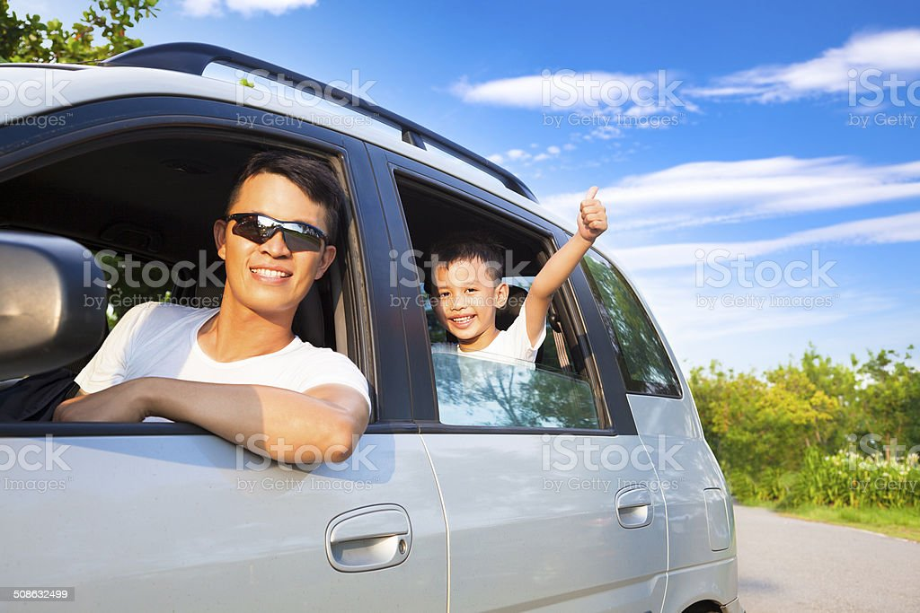 happy little boy with father sitting in the car stock photo