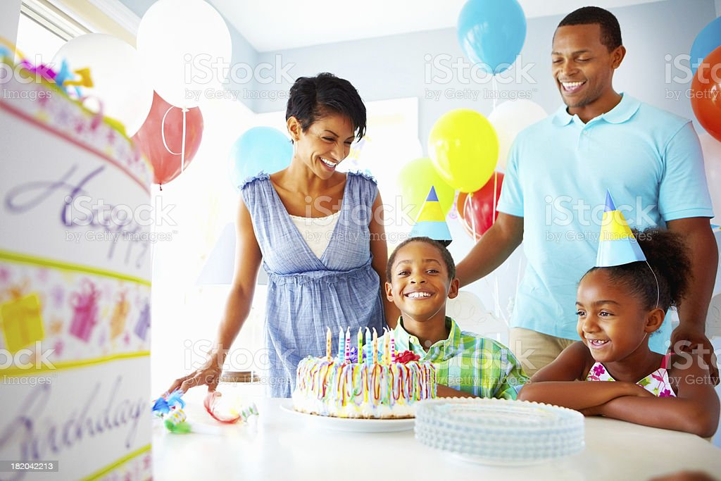 Happy little boy with his family celebrating birthday royalty-free stock photo
