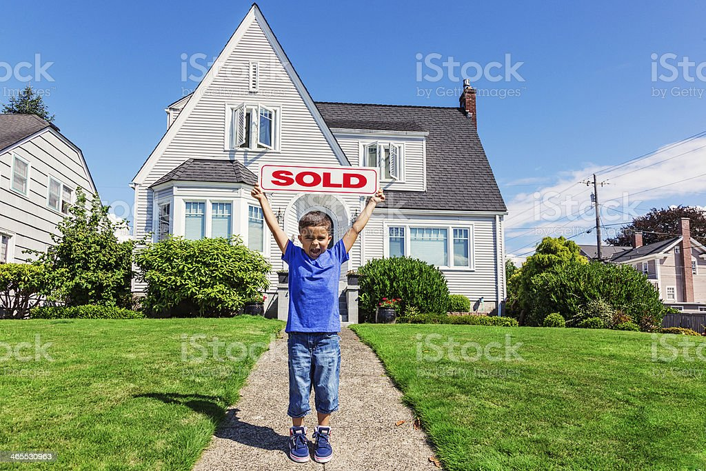 Happy Little Boy with Sold Sign stock photo