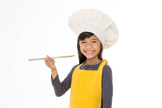 happy little chef smiling stock photo