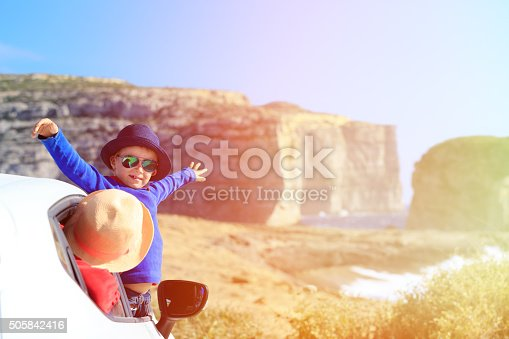 istock happy little child and mother travel by car 505842416