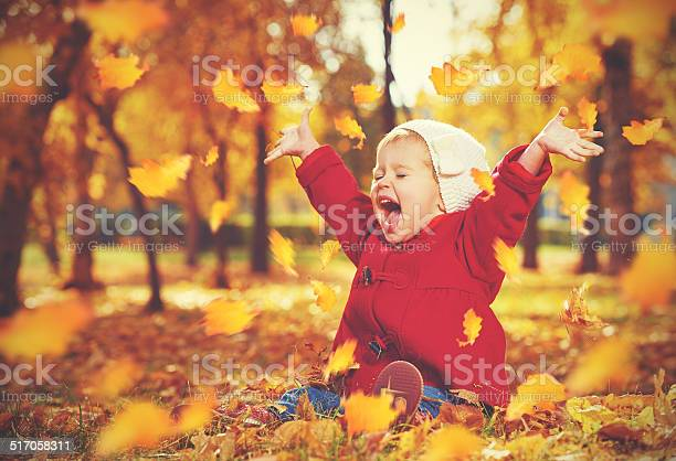 Happy little child baby girl laughing and playing in autumn picture id517058311?b=1&k=6&m=517058311&s=612x612&h=i7kuqubkgkb7dpfsoorwsdcjksbokeazmop1nybrios=