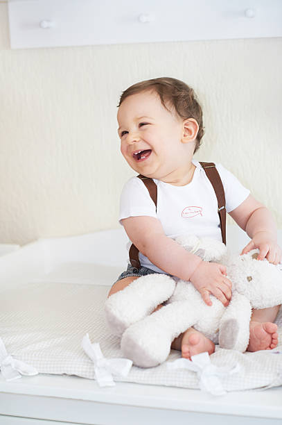 Happy little child, babyboy laughing and playing stock photo