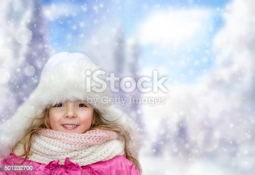 istock Happy little child girl outdoors on winter bakground,empty space. 501232700
