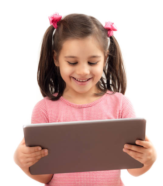 Happy Little Child Girl Using Digital Tablet, Isolated on White Background stock photo