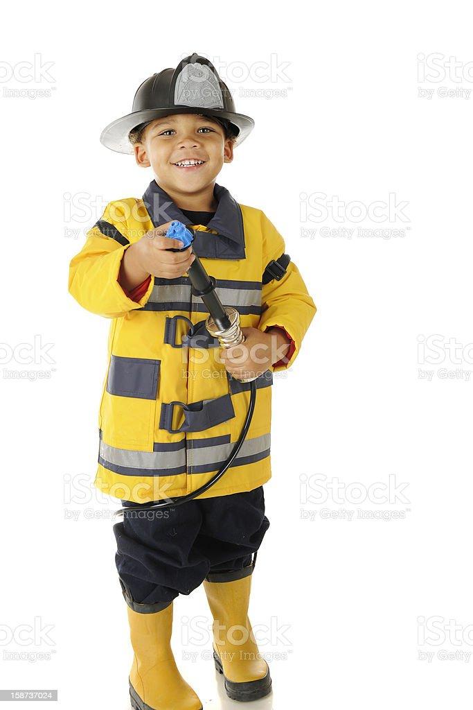 Happy Little Firefighter stock photo