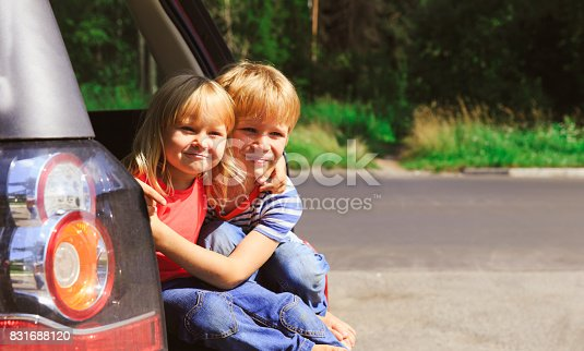 915609494istockphoto happy little girl and boy travel by car 831688120