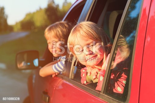 915609494istockphoto happy little girl and boy travel by car 831688328