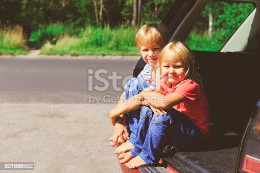 915609494istockphoto happy little girl and boy travel by car 831688552