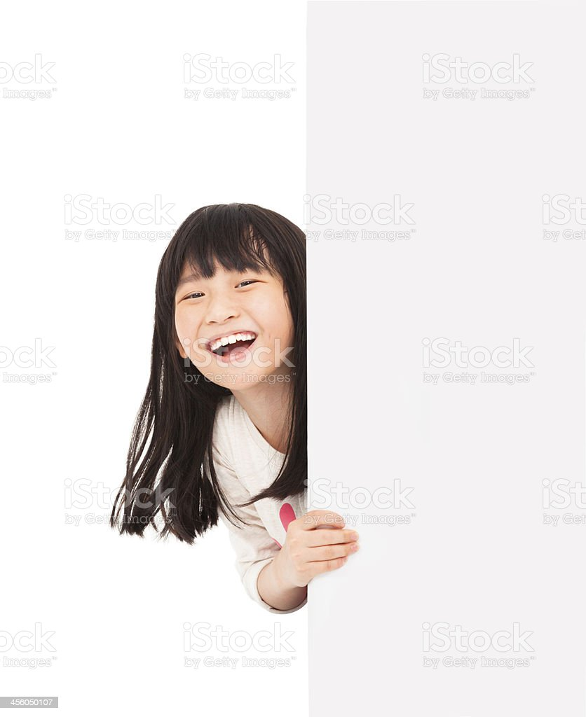 happy little girl behind a white board stock photo