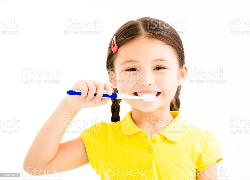 happy Little girl brushing the teeth stock photo
