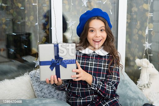 happy little girl celebrate winter holiday. happy new year. christmas time. By golly, be jolly. Cute little child girl with xmas present. delivery christmas gifts. Christmas is the time to please.