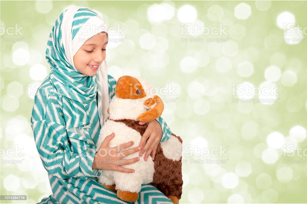 Happy little girl celebrating Eid ul Adha stock photo