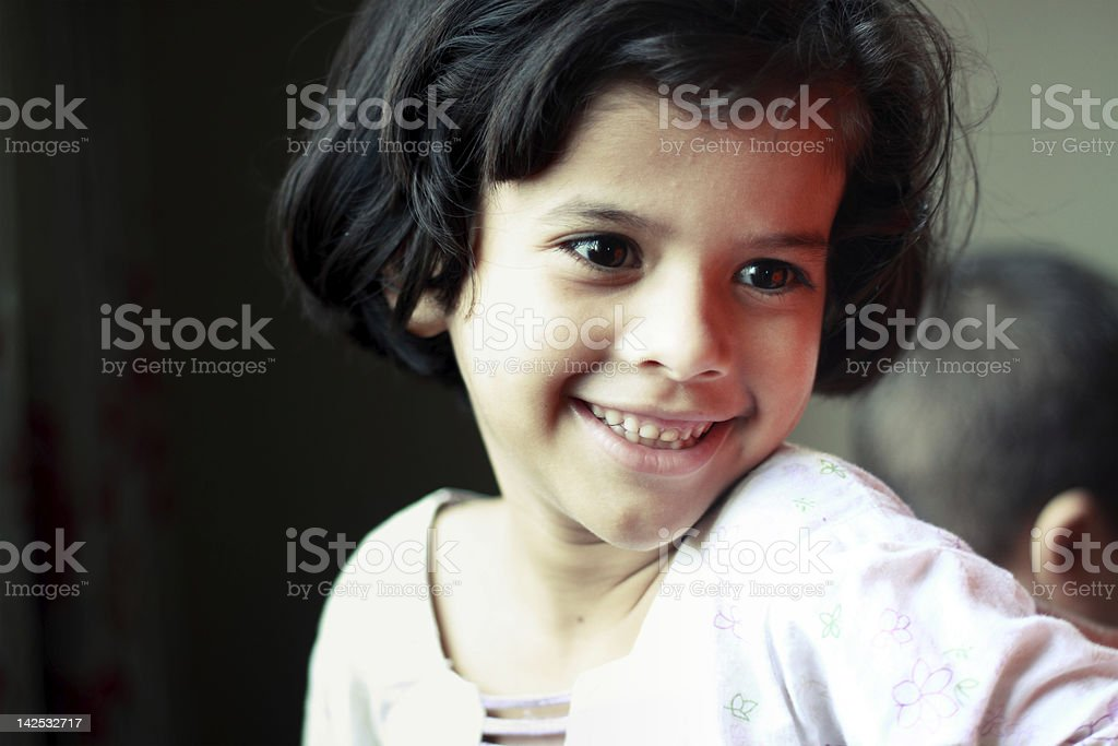 Happy little girl close-up stock photo