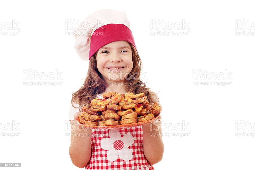 happy little girl cook with bruschetta on plate stock photo