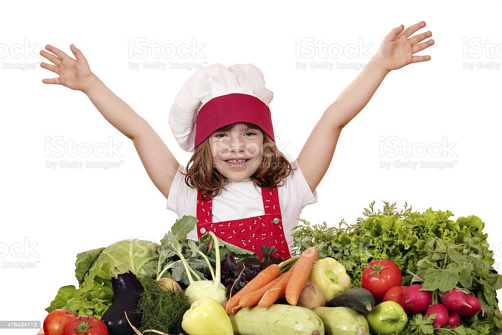 happy little girl cook with vegetables royalty-free stock photo