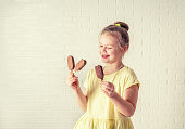 happy little girl eating popsicle at summer time, copy space