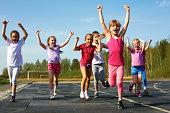 Group of children running on the treadmill at the stadium