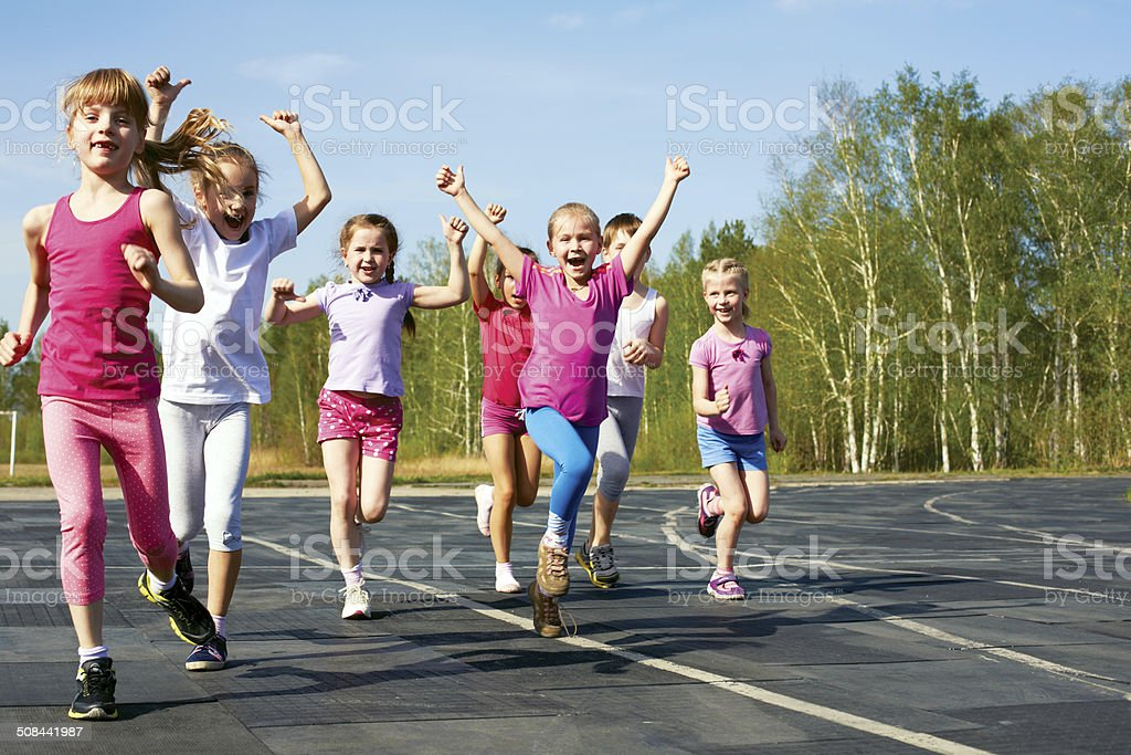 happy little girl finish first stock photo